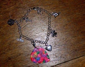 Charm bracelet with detachable plectrum