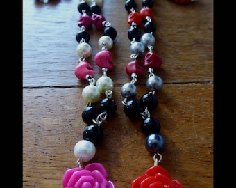 Rosary style necklace with rose and skulls