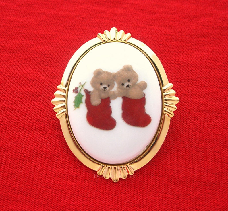 Porcelain Two TEDDY BEARS in Stockings adorned w Holly Costume Jewelry on a Goldtone Starburst Frame Pin Brooch Pendant for Christmas Gift