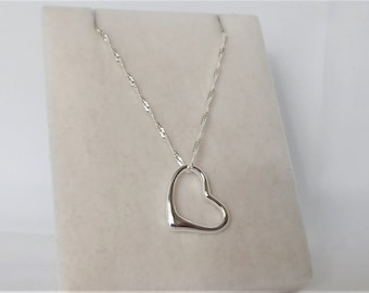 Sterling Silver Floating Heart Pendant Necklace.