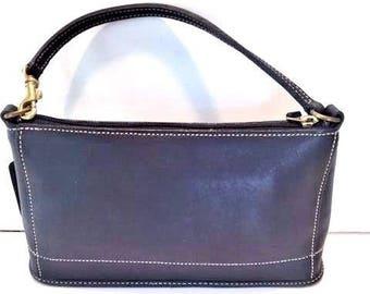 Black leather Coach handbag, brass metal hardware & contrasting stitching