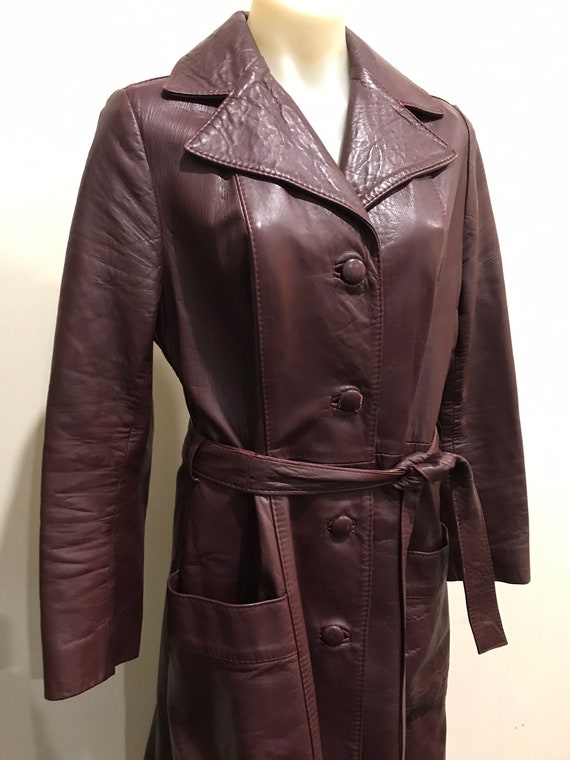 Gorgeous vintage 1970s belted burgundy leather coa