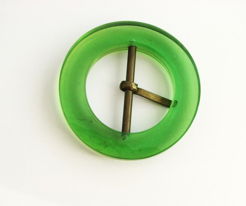 Large green belt buckle with prong