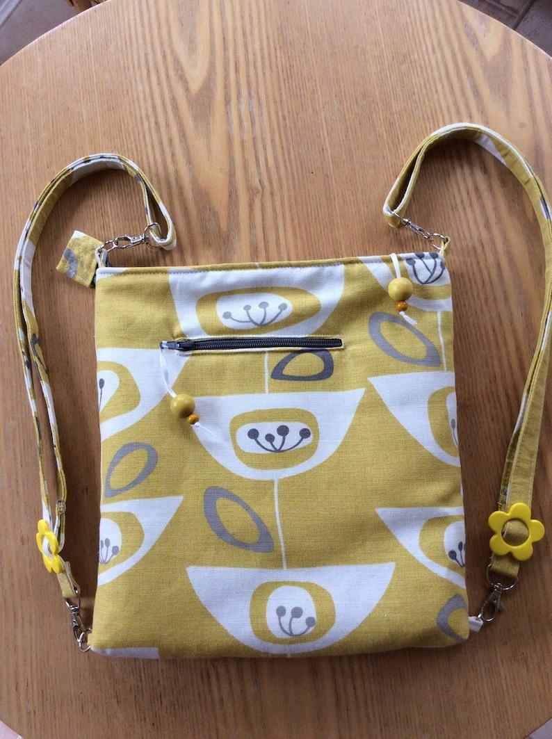Ladies cute yellow seed head fabric backpack rucksack image 0
