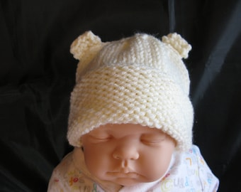 Cream Aran Hat with Ears for a 0 to 6 month old Baby approx. Brand New ,Handmade, Hand Knitted