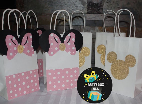 Minnie mouse and mickey mouse candy bags.