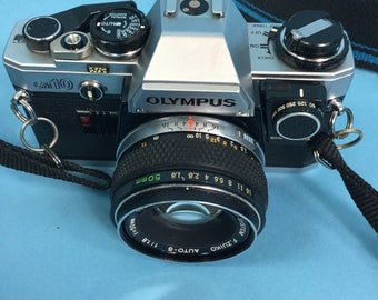 Olympus OM10 SLR 35mm Film Camera with Two Lenses And Manual Adapter