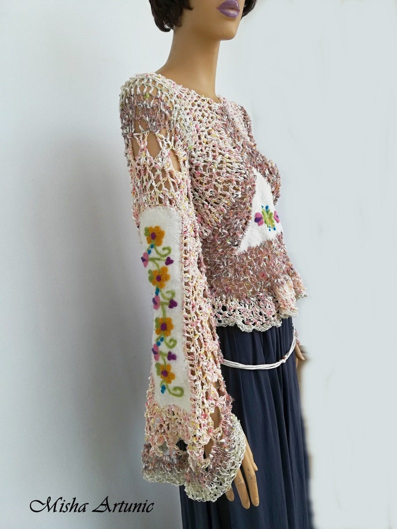 Knitted and felted blouse with felted flowers