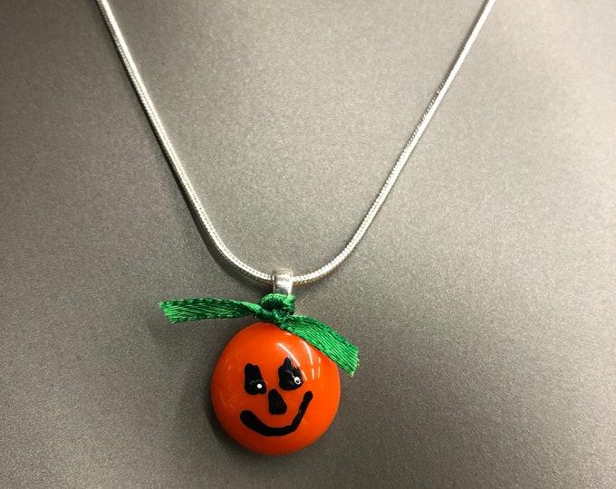 "Round orange pendand, pumpkin pendant, fused glass pendant.  Hand painted pumpkin face 18"" chain."