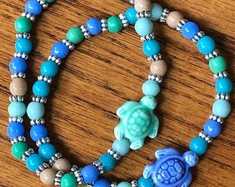 Turtle stretch bracelet, beaded sea turtle bracelet, ceramic turtle charm, turtle beaded stretch bracelet, colorful beaded turtle bracelet