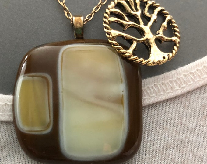 Fused glass warm brown pendant with hints of cream and swirls of brown.  Brown and cream necklace, brown pendant with tree of life charm.