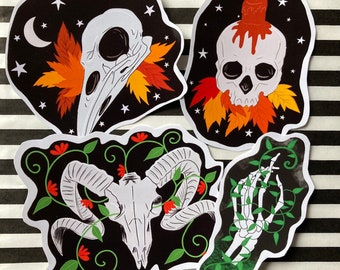 Set of 4 stickers, 3 skull themed and 1 skeleton sticker