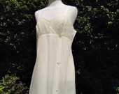 Vintage 1960s, 1970s pale lemon yellow nylon night dress, nightie, baby doll. Nightwear, boudoir, lingerie, sleepwear. Pin-up, glamour.