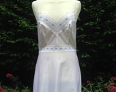 Vintage 1970s white and pale blue full nylon slip, petticoat. From Spinney. Lingerie, lounge wear, underwear.