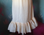 Vintage c. 1940s, 1950s Creamy Peach Petticoat, Waist Slip with Ruffle. Underwear, Lingerie.