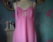 Vintage 1960s, 1970s bright pink nylon full slip, petticoat with white trim. St Michael. Underwear, lingerie. Pink.