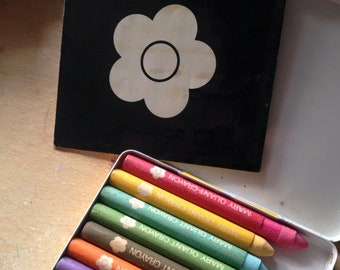 Vintage 1960s Mary Quant make-up crayon collection, in yellow tin with daisy design.