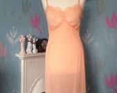 Vintage 1960s Vanity Fair Peach Bri Nylon Full Slip. Petticoat, Loungewear, Lingerie, Underwear. Unworn with Tags in Pack.
