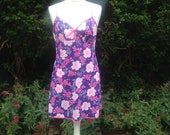 Vintage 1960s, 1970s floral patterned full slip, petticoat in shades of purple and pink. From Hazel Maid. Lingerie, lounge wear