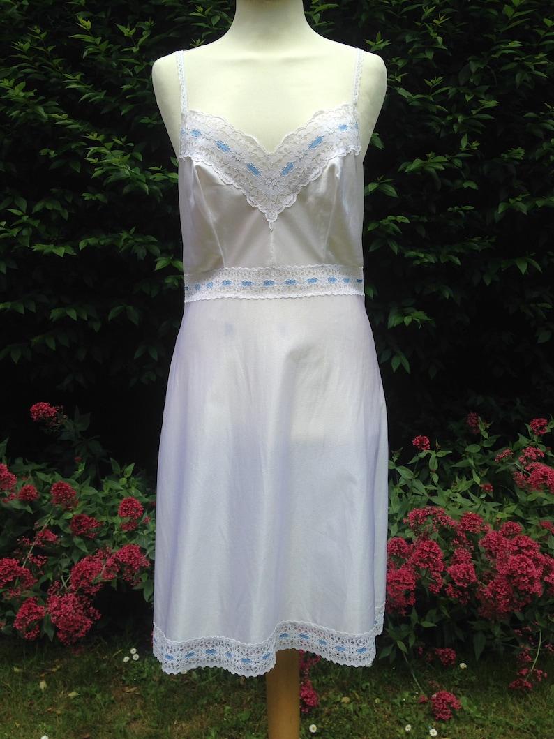 Vintage 1970s white and pale blue full nylon slip petticoat. image 0