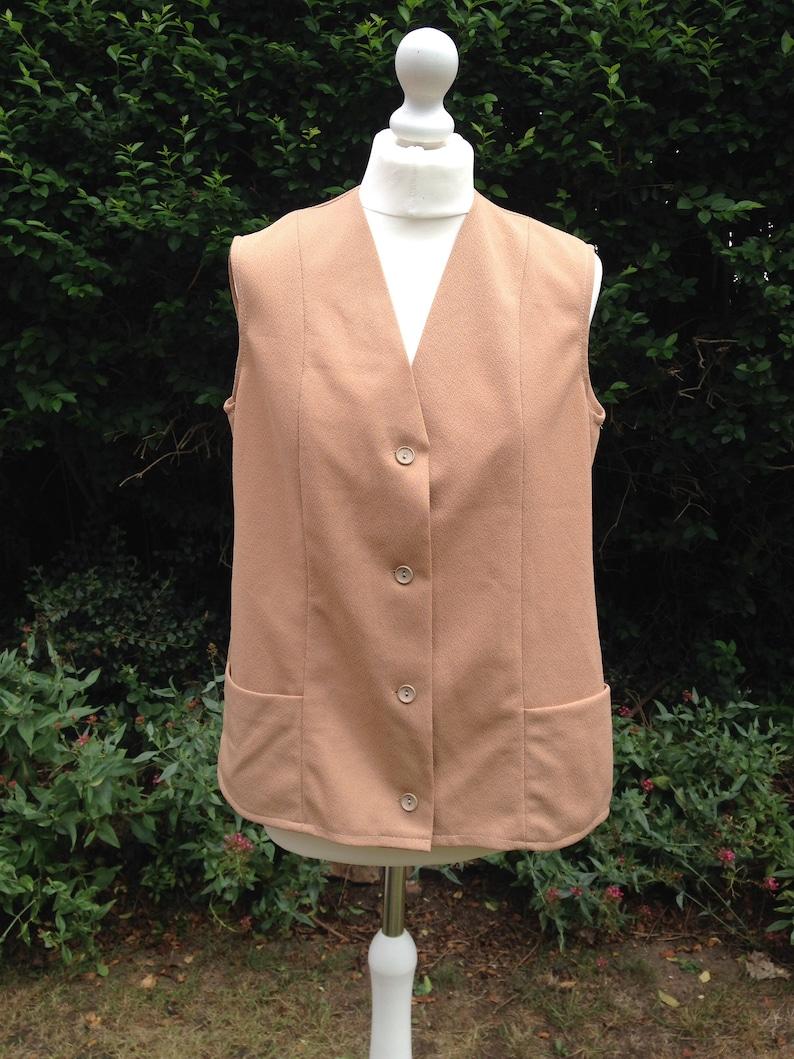 Vintage 1970s Ladies Light Brown Polyester Sleeveless Jacket. image 0