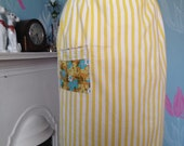 Vintage 1950s, 1960s cotton half apron, pinny with yellow stripes and floral pocket. Kitchen, afternoon tea, domestic goddess. vintage tea.