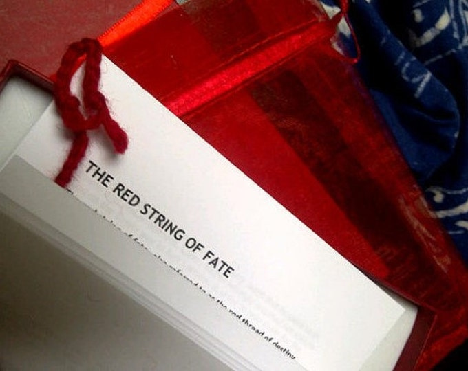 The Red String of Fate:  a boxed scarlet thread to wear on the wrist to connect lovers or protect the wearer from danger
