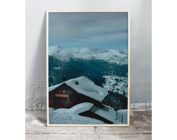 Photography art print of snowy Swiss alp chalet and the Swiss alps in Nendaz Switzerland. Printed on high quality, matte paper.