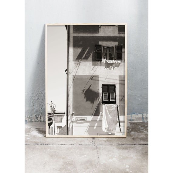 Black and white digital downloadable photo of building by the beach in Italy.
