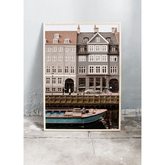 Photography print of old buildings and tour boat in Nyhavn in Copenhagen , Denmark.