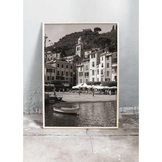 Black and white digital downloadable photo of the buildings and harbour in Porto Fino in Italy.