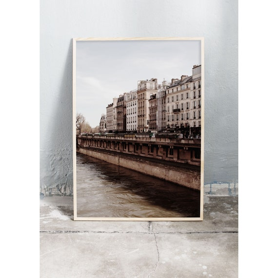 Photography art print of buildings by the river Seine in Paris. Print is printed on a high quality, matte paper.