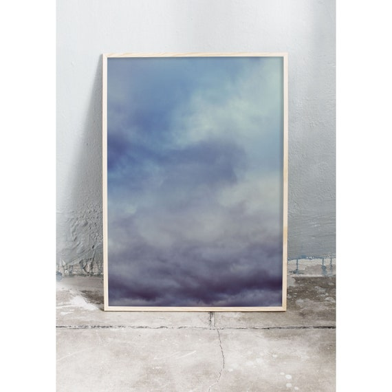 Photography print of grey and dark blue clouds. Prints are printed on a high quality, matte paper.
