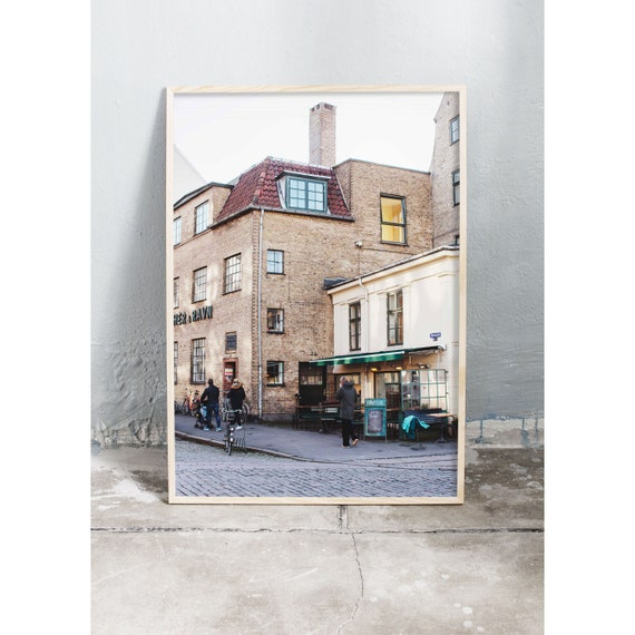 Photography art print of yellow brick building in Copenhagen. Photo is printed on a high quality, matte paper.