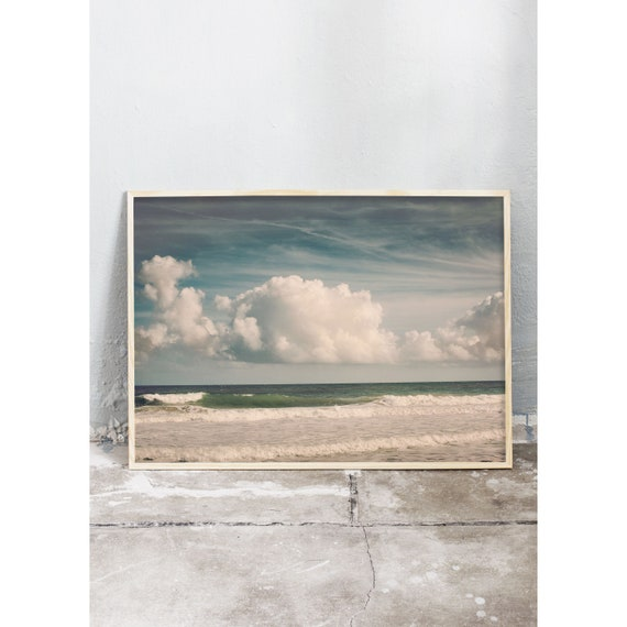 Photography art print of the beach, ocean, waves and clouds on the east coast of Florida. Print is printed on a high quality, matte paper.