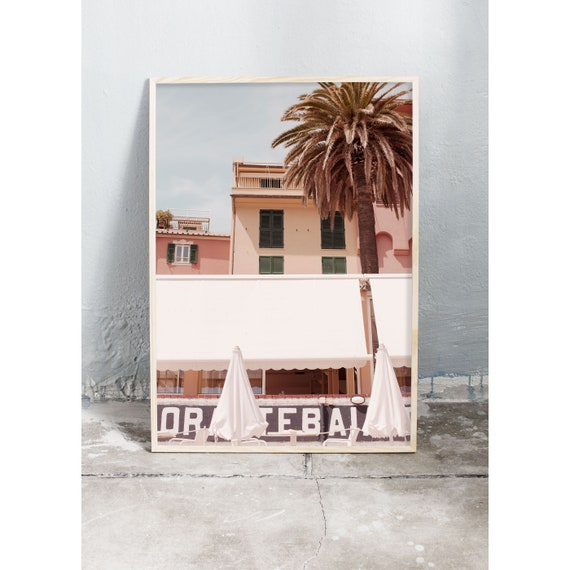 Photography art print of pink buildings, parasols and palm tree on the beach in Sestri Levante, Italy. Printed on high quality, matte paper.
