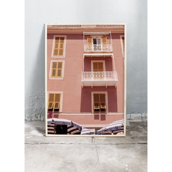 Photography art print of pink buildings and parasols by the beach in Sestri Levante, Italy. Printed on high quality, matte paper.
