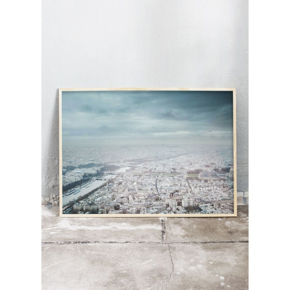 Photography art print of a grey and blue Paris from above. Taken from the Eiffel tower. Print is printed on a high quality, matte paper.