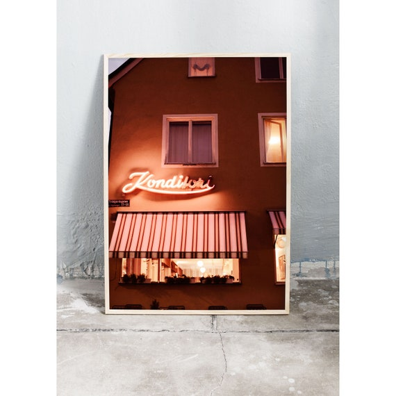 Night time photography art print of orange building with neon sign in Sweden. Print is printed on a high quality, matte paper.