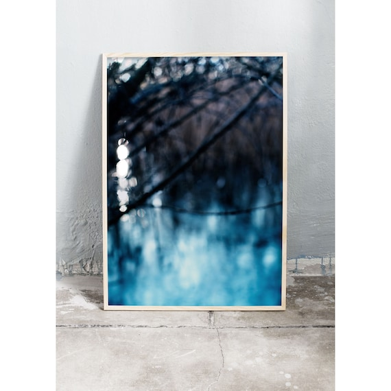 Abstract photography art print of a blue frozen lake, trees and common reed. Print is printed on a high quality, matte paper.