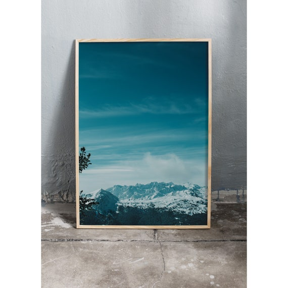 Photography art print of snowy mountains and clear blue sky in the Swiss alps. Printed on high quality, matte paper.