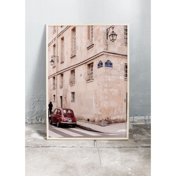 Photography art print of a building and red car in Marais, Paris. Print is printed on a high quality, matte paper.