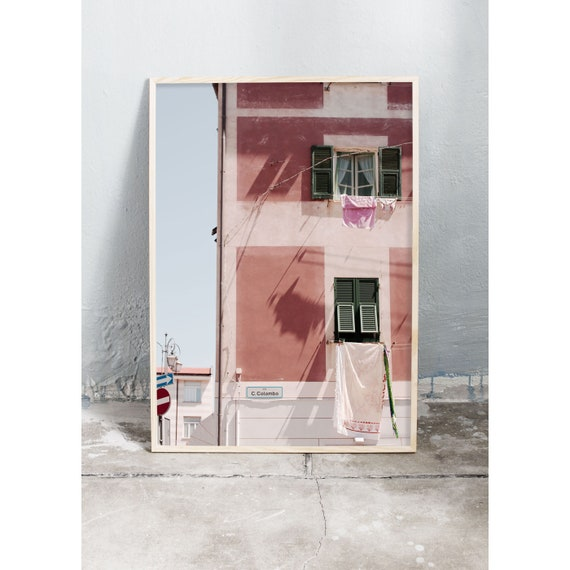 Photography art print of a  pink building in Riva Trigoso, Italy. Printed on high quality, matte paper.