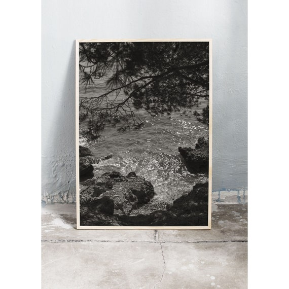 Black and white digital downloadable photo of the rocks by the ocean in Croatia.