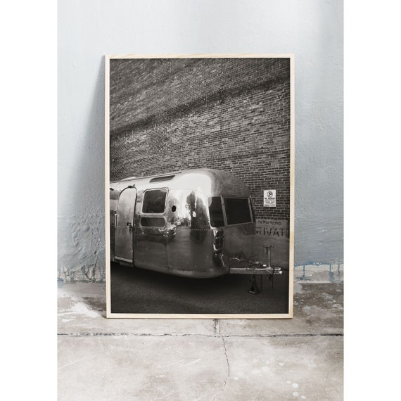Black and white digital downloadable photo of an airstream camper infront of a brick wall in Nashville