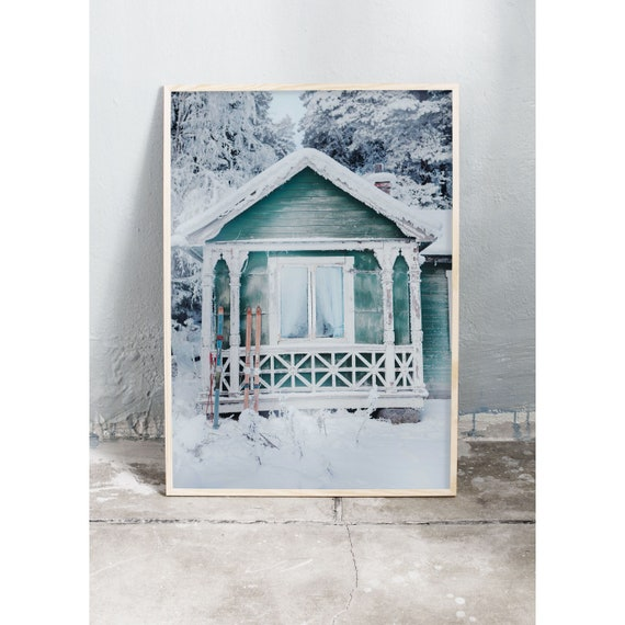 Photography art print of tiny, green, fairytale cottage in the woods covered in snow. Print printed on high quality, matte paper.