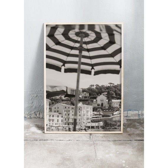 Black and white digital downloadable photo of buildings and parasols on the beach in Sestri Levante, Italy.