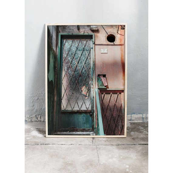 Photography art print of a pink and green old door in Italy. Print is printed on a high quality, matte paper.