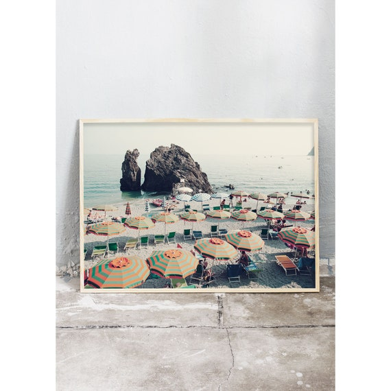 Photography art print of the colourful parasols on the beach of Cinque Terre in Italy. Print is printed on a high quality, matte paper.