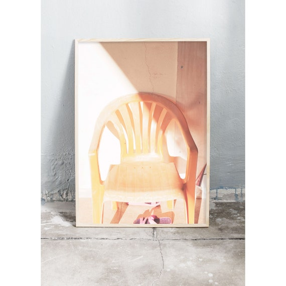 Photography art print of a yellow garden chair in the sunshine. Print is printed on a high quality, matte paper.